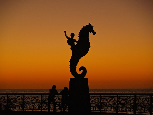The sun sets on the Malecon