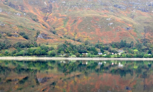 The colours of the hills reflected in the loch