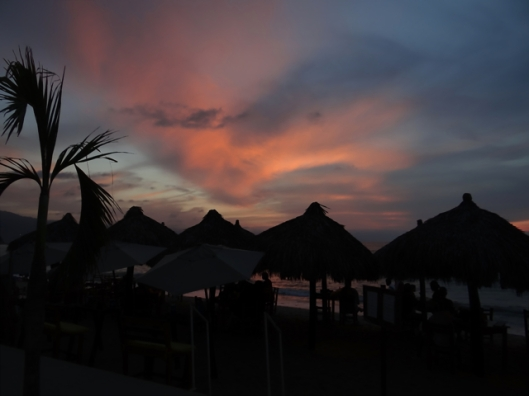 Restaurant Palapas silhouetted in the sunset