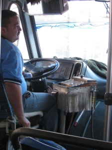 Notice the driver has his ticket pack and change box at his right hand.  He changes f=gear, opens and shuts the door, hands put tickets and receives and gives change while driving.