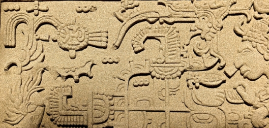 Aztec inspired sand-art bass relief