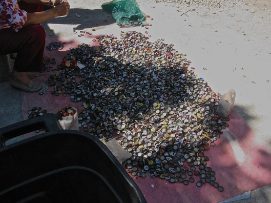 So what do you do with hundreds of used beer-bottle caps?