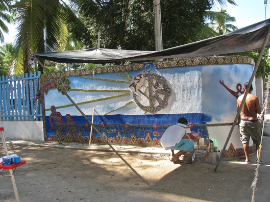 The mural in progress